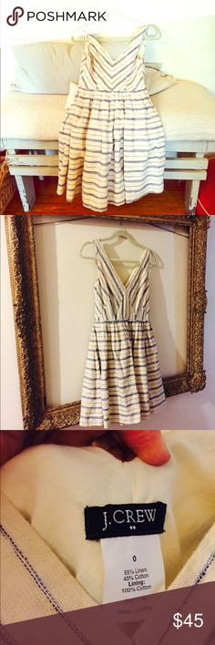 J Crew Linen/cotton Summer Dress This adorable dress is cream with blue stripes. It has a fitted bodice, deep V-neck, and side pockets. It is a linen/cotton blend and is fully lined. Timeless. J. Crew Dresses