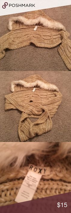 Roxy fur trimmed knotted scarf/beanie Roxy tan knitted scarf/beanie  with fur trim. The Beanie and scarf are knotted together so it's like 2 in 1 😄. Different and unique good for the winter and stylish as well. Used once like new. Soft and cozy Roxy Accessories