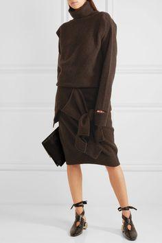 Dark-brown wool Slips on 100% wool Dry clean Designer color: Mahogany Made in Italy
