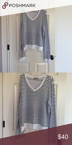 Wildfox Beach Sweatshirt A slouchy Wildfox pullover in a nautical stripe. V Neck with extra long sleeves that lock cute either worn long or rolled up. So so comfortable. Size L - Perfect for a baggy look; could easily fit an XL as well. Wildfox Sweaters V-Necks