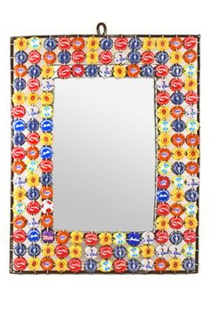 We love African recycled art. We're even more in love when the art serves a function in the home, like this vibrant wall mirror.    Senegalese artisans use a rainbow of recycled bottle caps to create this unique wall mirror. Generously sized, the mirror is fashioned with a metal frame for stability, and the back includes hanging hardware.