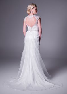 V-neck, soft and slim wedding gown with beaded straps.