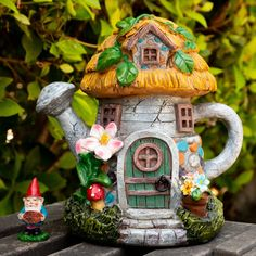 Inspire garden cheer with the Alpine Waterford Fairy House Garden Statue with Mika Gnome Figurine . This pair of garden statues is crafted from polyresin,. Clay Fairy House, Fairy Garden Houses, Smurf House, Mason Jar Garden, Enchanted Tree, Clay Fairies, Miniature Fairy Gardens, Garden Statues, Diy Clay