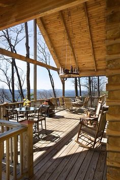 The popular rear deck provides nearly 900 square feet for family and friends to gather and enjoy sunset views or a meal prepared on the gril. Cabin In The Woods, Home In The Mountains, Log Home Living, Log Cabin Homes, Log Cabins, Mountain Homes, Mountain Living, Cabins And Cottages, Home Photo