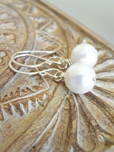 The Paper Moon earrings - dazzling white south sea shell pearls are finished with my signature ear wires in sterling.  Easy care, maintanence free pearls, with a beautiful lustre!