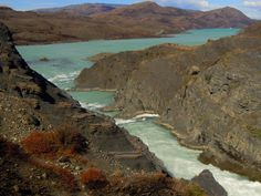 Germán Vogel posted a photo:  [Torres del Paine National Park, Magallanes y Antartica Chilena, Chile] Dramatic bend or curve of a glacial river, beautifully colored in turquoise, opening its way in the middle of the otherwise arid surrounding Patagonia steppe, in a contrasting landscape of nature.  Follow my photos in Facebook  ©2017 Germán Vogel - All rights reserved - No usage allowed in any form without the written consent of the photographer.