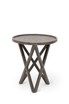<ul> <li> Salvage mango wood side table</li> <li> Pylon legs</li> <li> Circular table top with lipped edge</li> </ul>