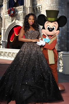 Jennifer Hudson with Mickey Mouse at the Magic Kingdom. Wow, I LOVE that dress!!!