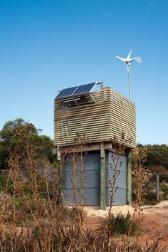 Wind power, solar power, and collected rain water.  Wow cool - I would love this