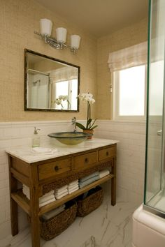 This transitional neutral guest bathroom features a vanity made from a  Chinese cabinet  then toppedThis small guest bathroom packs in a lot of style  with a fully  . Guest Bathroom. Home Design Ideas