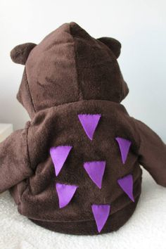 """""""He has purple prickles all over his back.""""  An easy way to create a Gruffalo costume for World Book Day. Adapt a brown hooded jumper, and add some purple prickles!"""