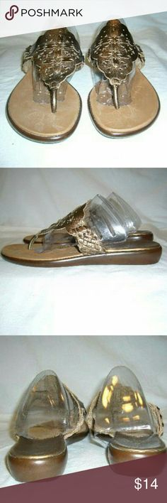 Bronze Sandal Slides Leather straps cute cut outs on top of the straps straps have rated sides. Shoes have rubber soles man-made uppers worn twice approximately 1 inch high. Coral Bay Shoes Sandals