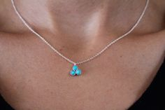 Visibly Interesting: Tiny Sterling Silver pendant necklace set with a three 3mm Turquoise stones