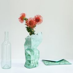 Dutch designer Pepe Heykoop has created a paper cover to turn any glass jar or bottle into a faceted vase