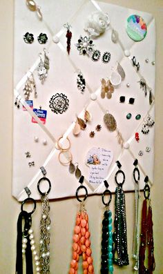 Organize all your jewelry using just a corkboard photo holder and shower curtain rings!