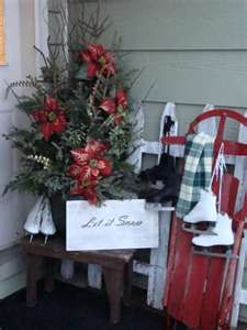 hanging a pair of skates over an old sleigh is an awsome winter display for a porch area; definetly says winter! add some festive touches for Christmas