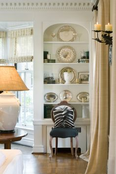 Neat way to display all those pretty silver platters instead of leaving in silver bags in drawers!