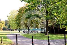people-sitting-relaxing-preston-park-bright-day-traffic-bollards-foreground