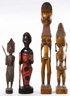 Lot 726: African Carved Wood Tribal Statues; 20th Century, four statues of males and females
