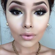 I would use a shade lighter on her highlight, almost looks ashy/sallow, but this was great contouring and she's beautiful.