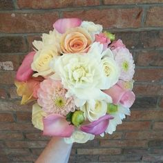 summer bridal bouquet, featuring dahlia, calla lily and roses.