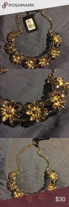 Saks 5th Avenue Gold Flower Statement Necklace Brand new with tags.  Perfect statement necklace to pair a festive holiday outfit!!   Got this as a gift last year and never had the chance to wear it.  Not really my style but it's a beautiful piece of jewelry.    Selling this piece at a discount!!  (And more to come as I am trying to make space in my closet). Saks Fifth Avenue Jewelry Necklaces