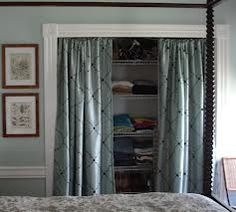 diy closet doors - curtains as doors- like the moulding idea to frame it.