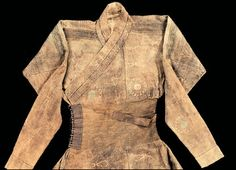 The top section of a robe from the Mongol period with very long sleeves and intricate buttons, Yuan Dynasty 1271-1368 AD.