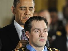 President Obama awards the Medal of Honor to Clinton Romesha at the White House on Monday.