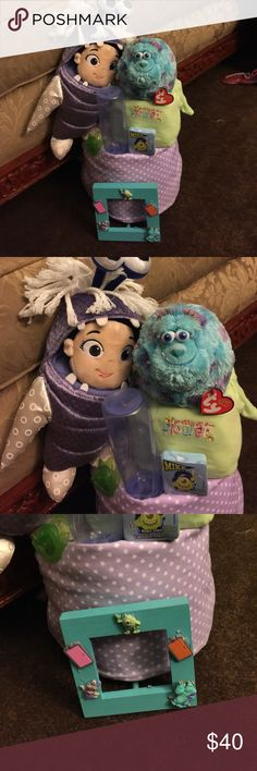 Girl monster inc diaper cake Receiving blanket  Onesie  Mike wash cloth Frame Bottle Pacifier  Ty sulley Large stuff boo in costume  Huggie or luv diapers  Wrap in plastic with ribbon Disney Accessories