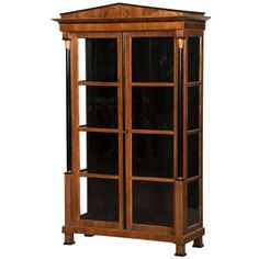Empire style walnut vitrine having ebonized columns, Austria c.1890 | From a unique collection of antique and modern vitrines at https://www.1stdibs.com/furniture/storage-case-pieces/vitrines/