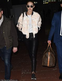 Slick:Make-up free Gigi Hadid, 21, looked stylish in leathers as she jetted into Paris on...
