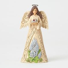 Monthly Angel figurine by Jim Shore for Heartwood Creek.Angel is 6.25, crafted of stone resin with the look and feel of handcarved woodRaised border and wing designs in rosemaling pattern, a trademark of Jim Shore'sIn her hand, the sparking, colored crystal birthstone of the monthOn her skirt, a colorful arrangement of the flower of the month in beautiful color and attention to detailJuly, birthstone is ruby, flower is delphiniumCollectible birthstone birthday angel figurine or for gift-giving o Rosemaling Pattern, Birthday Angel, Wings Design, Delphinium, Birthstones, Hand Carved, Resin, July Birthstone, Colorful