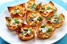 Crispy wontons are filled with a spicy chicken mixture, topped with blue cheese, and baked until bubbly. Description from recipecorner.com. I searched for this on bing.com/images