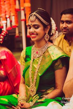 South Indian Jewelry - Bride in a Green Kanjivaram Saree with a Gold and Ruby Matha Patti and Polki Set | WedMeGood #wedmegood #indianbride #indianwedding #southindianbride #southindianwedding #kanjivaram #green #jewelry #indianjewelry