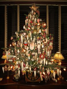 table top tree on the sideboard in the dining room. All antique cotton ornaments, wax angels, squeaker Santa's and glass kugels Antique Christmas Decorations, German Christmas Ornaments, Tabletop Christmas Tree, Xmas Tree, Christmas Home, Christmas Trees, Christmas Holidays, Merry Christmas, White Christmas