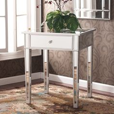 Bedside tables - @Overstock - Perfect for any room, this glamorous mirrored side end table will complement your home. With its mirrored finish, it adapts to any surroundings without being overpowering and functions as well in the living room as it does bedside.http://www.overstock.com/Home-Garden/Sanira-Mirror-Side-End-table/5400890/product.html?CID=214117 $182.99