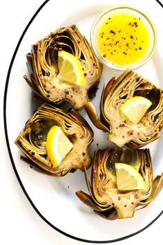 Seriously the most amazing roasted artichokes recipe! They're stuffed with lots of garlic and herbs, seasoned with lots of lemon and black pepper, and roasted to crispy, tender perfection. The perfect vegetable side dish! Vegetable Side Dishes, Vegetable Recipes, Vegetarian Recipes, Cooking Recipes, Healthy Recipes, Argula Recipes, Coliflower Recipes, Roasted Artichoke Recipe, Roasted Artichokes