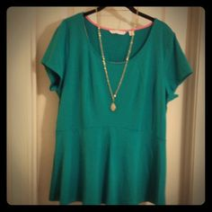 Peplum Shirt! Great everyday t-shirt with princess seaming and a peplum. Great to wear by itself or underneath jackets or cardigans. It reads more blue in the pictures than it is. It has some blue but a true green color. Made by Issac Mizrahi. Never worn. Issac Mizrahi Tops Tees - Short Sleeve