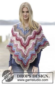 """Knitted DROPS poncho with stripes and wave pattern, worked top down in """"Eskimo"""". Free Pattern"""