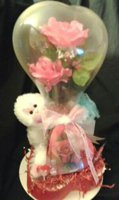 Created by Niftygiftsbystacy. ...Flower stuffed gift heart shape balloon
