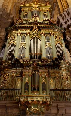 Extraordinarily large, elaborate, green organ in Malaga Cathedral, Malaga, Spain.  The cathedral was built over the 16th-18th centuries.  I don't know when the organ was built.