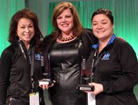 Helen O'Hanlan and Amy Del Rosario-Bechler Accepting Courtyard Silver Circle Hotel Awards