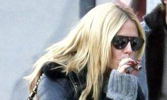 Heidi Klum, 42, puffs on a cigar during date day in St Moritz