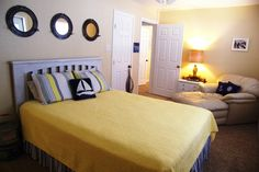 Fun Nautical feel for this Master Bedroom.