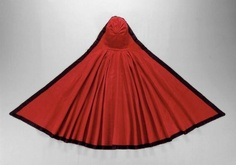 Woman's hooded cloak  Woman's riding hood  American, last quarter of the 18th century  Lexington, Massachusetts, United States  PLACE OF MANUFACTURE  England (textile)  PLACE OF MANUFACTURE  Massachusetts, United States  DIMENSIONS  Overall: 115.6 x 248.9 cm (45 1/2 x 98 in.)  MEDIUM OR TECHNIQUE  Plain weave wool (broadcloth), plain weave silk trim and facing