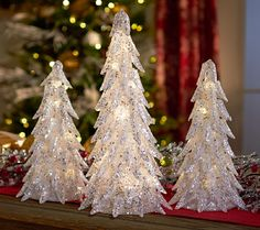 Create a stunning centerpiece using these glistening Valerie Parr Hill trees. Their textured design, glitter, and sequins are complemented by a warm, inviting glow. Set the four-hour timer and they come on and turn off at the same time each evening. From the Valerie Parr Hill Collection.<br><br>Original item is H205801. This product may be a customer return, vendor sample, or on-air display and is not in its originally manufactured condition. It may not be new. In some instances, these…