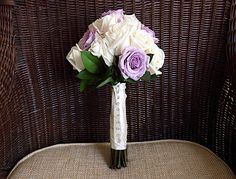 Wedding Flowers: Stunning hand tied bridesmaid bouquets made from lavender and white roses with jewels.