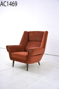 Large Danish armchair in rust colour upholstery Large and comfortable vintage…