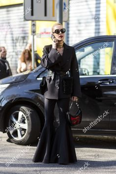 Find the editorial stock photo of Street style, and more photos in the Shutterstock collection of editorial photography. Photo Stock Images, Stock Photos, Live Events, Wide Leg Jeans, New Image, Editorial Photography, Flare Jeans, Bell Bottoms, Women Wear